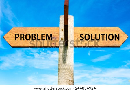 Wooden signpost with two opposite arrows over clear blue sky, Reactive versus Proactive messages, Behavior conceptual image - stock photo