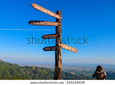 wooden signs, signboard and direction arrows at Chiang Rai province, Thailand - stock photo