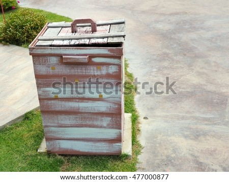 Wooden slatted litter bin.