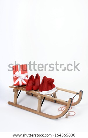 Wooden sleigh loaded with christmas gifts - stock photo