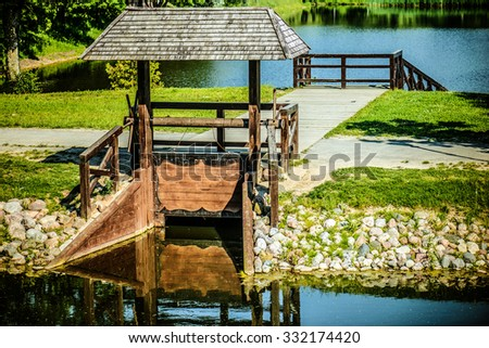 Wooden sluice on the summer river.