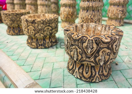 Wooden small vase on sale in Tangkuban Perahu, Indonesia. These wooden vase were made from special batik wood only grown here. - stock photo