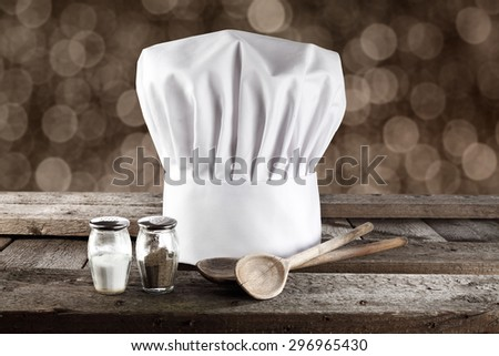 wooden space and wooden spoons and cook hat