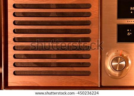 wooden speaker grille on a vintage radio - stock photo