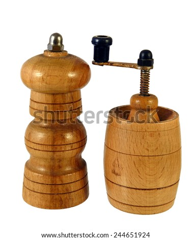 Wooden spice grinders and wooden pepper mill on white background
