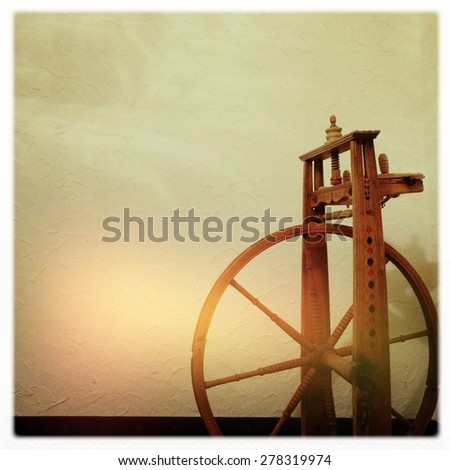 Wooden Spinning Wheel, Toned Photo, Camera Effect, Soft Focus for Background, Retro, Vintage - stock photo