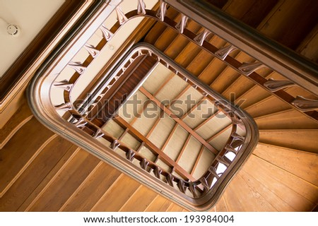 Wooden spiral staircase in an old building, Nancy, France - stock photo