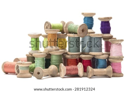 wooden spools with colored cotton threads for sewing, vintage - stock photo