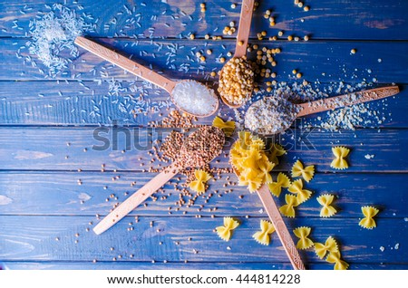 wooden spoon, a range of cereals,pasta