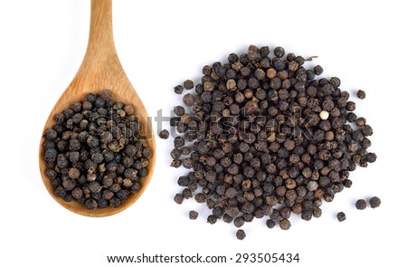 Wooden spoon and black peppercorn on white background