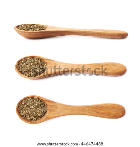 Wooden spoon and dried basil seasoning composition, isolated over the white background, set of three different foreshortenings