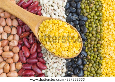Wooden spoon and dried soybeans