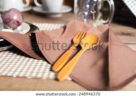 Wooden spoon and fork Placed on the napkin. Set the table - stock photo
