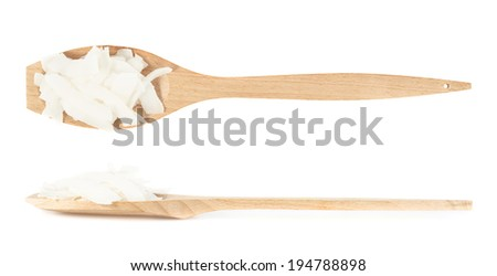 Wooden spoon full of coconut's chips isolated over the white background, set of two foreshortenings - stock photo