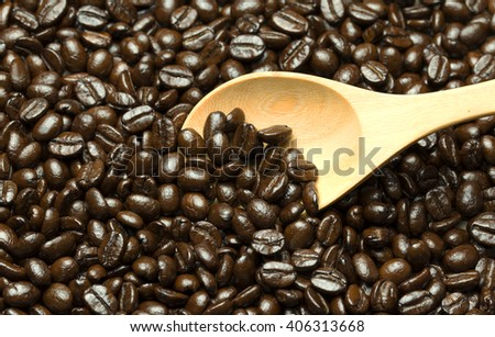 wooden spoon in the coffee beans - stock photo