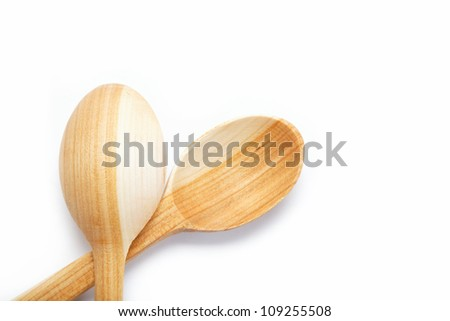 Wooden spoon isolated on a white background.