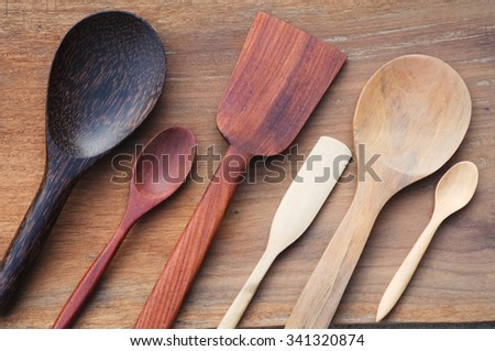 Wooden Spoon, ladle, spatula, flipper, wooden butter knife set on rustic wooden background - stock photo