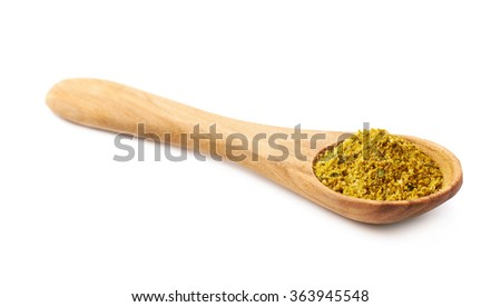 Wooden spoon of curry isolated - stock photo