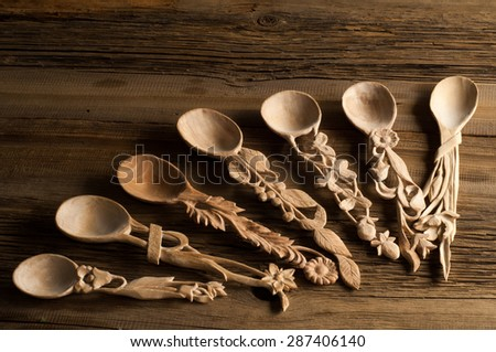 Wooden spoon photographed in studio on a wooden board - stock photo