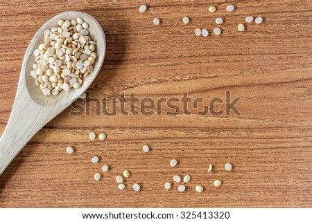 Wooden Spoon with bean - stock photo