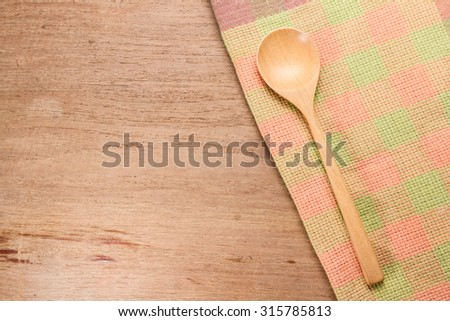 wooden spoon with cloth on table