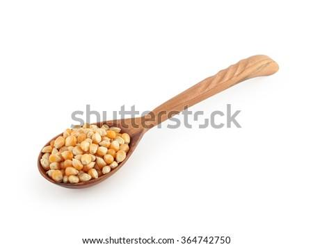 wooden spoon with corn grain - stock photo