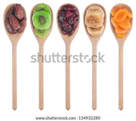 Wooden spoon with dried apricots, figs, dates, kiwi and cranberries isolated on white background - stock photo