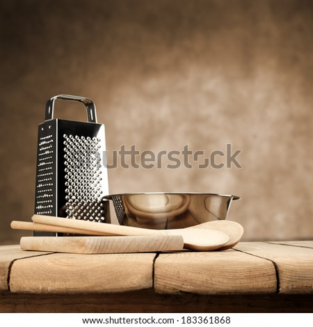 wooden spoons in kitchen and metal decoration  - stock photo