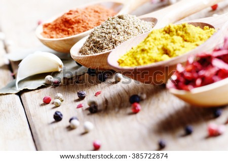 Wooden spoons of spices on table with copy-space