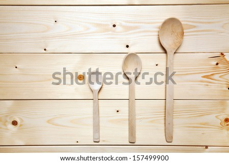 Wooden spoons on a table - stock photo