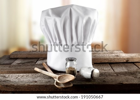 wooden spoons window in kitchen and cook hat