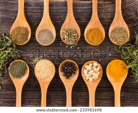 Wooden spoons with spices - stock photo