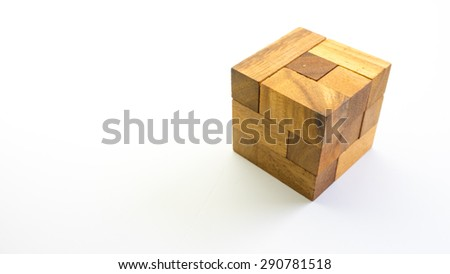 Wooden square block cube puzzle. Isolated on white background. Concept of complex and smart logical thinking. Slightly defocused and close up shot. Copy space. - stock photo
