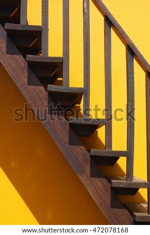 Wooden Stair on the yellow wall