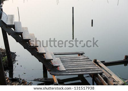 wooden stair to canal.