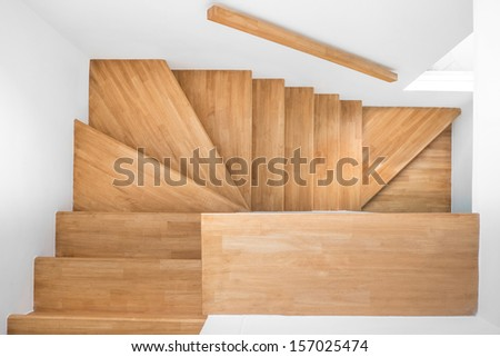 wooden stair to second floor in clean house - stock photo