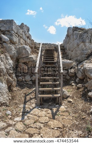 Wooden staircase amid the ruins