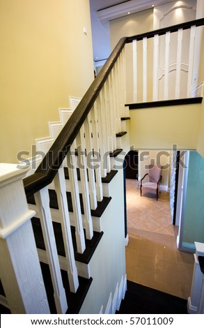 wooden staircase and bannister in a modern home. - stock photo