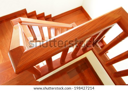 Wooden stairs and handrail - stock photo