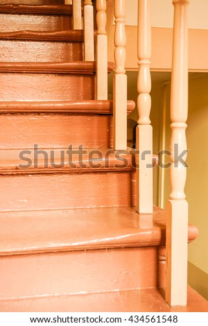 Wooden stairs at a hall painted in brown - stock photo