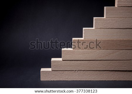 Wooden stairs, black background
