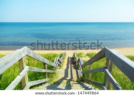wooden stairs down to the beach - stock photo