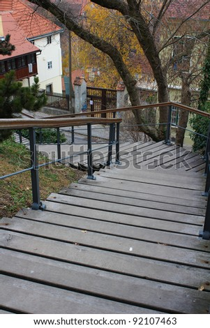 Wooden Stairs Going Downwards with a bent to the left