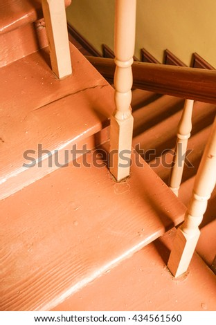 Wooden stairs in a hall painted in brown - stock photo