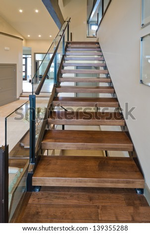 Wooden stairs to the upper level. Interior design. Vertical. - stock photo