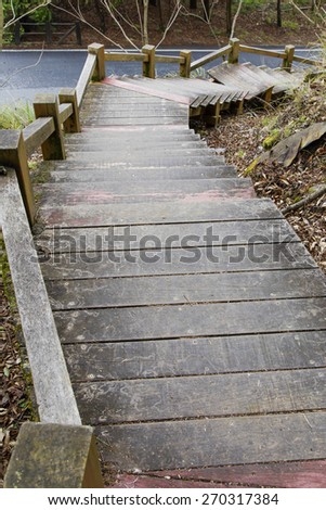 Wooden stairway downwards - stock photo