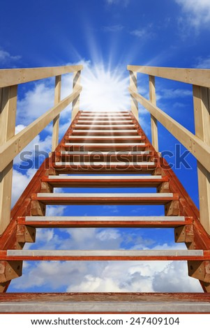 Wooden stairway to the bright light source in the sky - stock photo