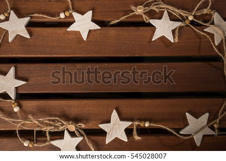 Wooden stars and the rope on the table.