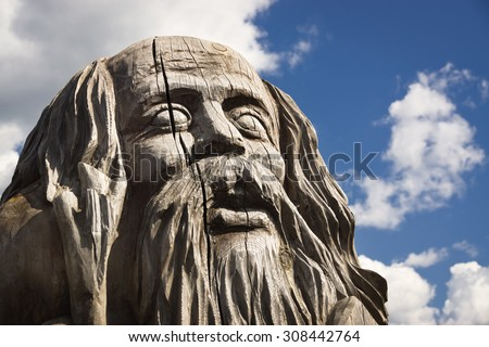 Wooden statue of the idol. Public object  - stock photo