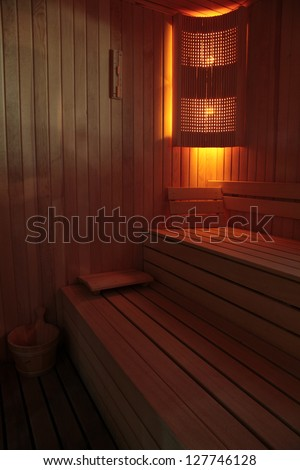 Wooden steam room in sauna - stock photo